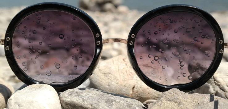 round sunglasses on the beach