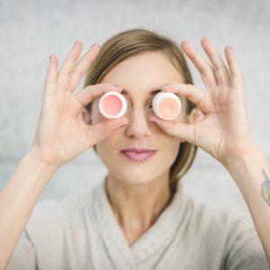 woman showing face creams