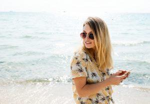 woman on the beach wearing sunglasses