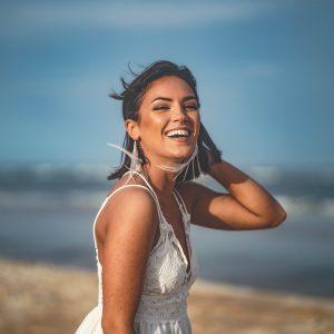 smiling woman white dress