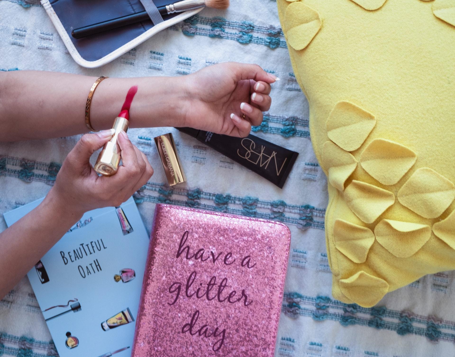 gold bracelet and glitter notebook