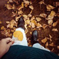 woman in midi boots