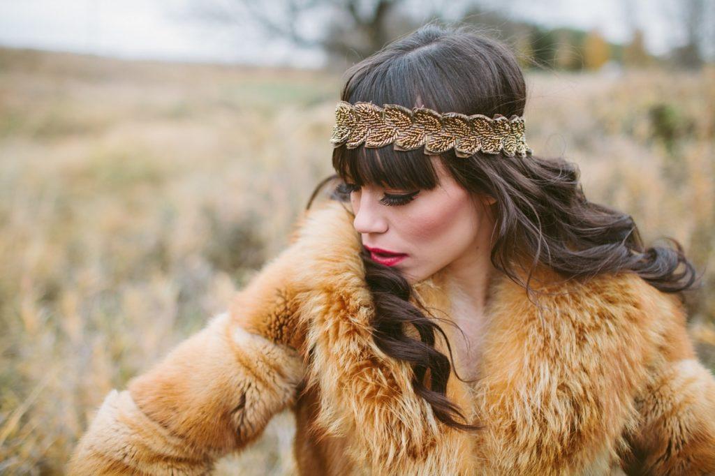girl wearing fur coat