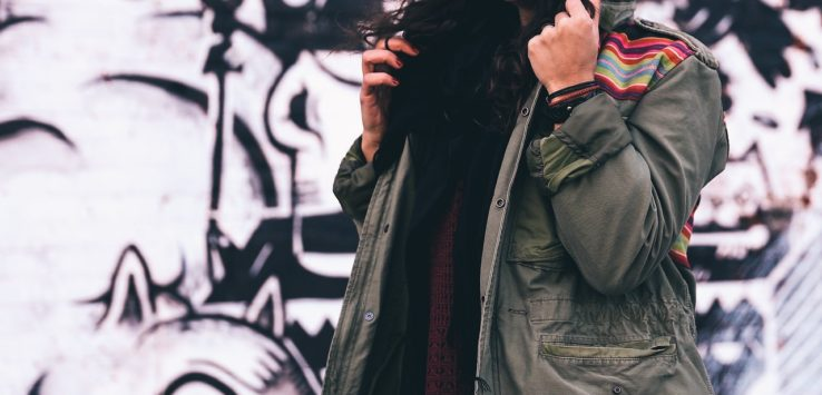 girl in military green parka