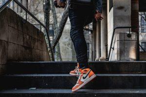 man wearing orange sneakers