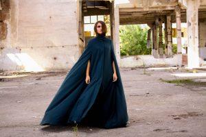 woman in a cape