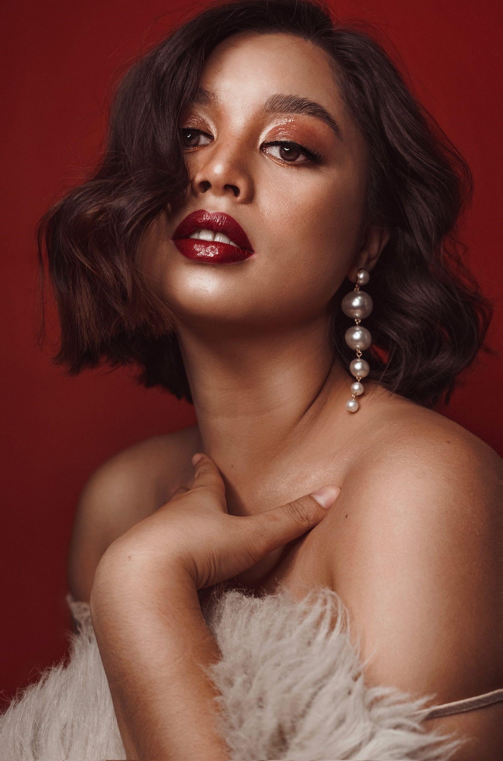 woman wearing pearl earrings