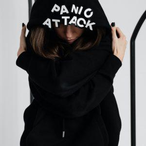woman in a black hoodie