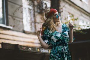 woman in a tropical print dress