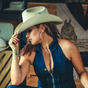 women in a brown cowboy hat